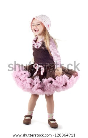 Little laughing girl in studio - stock photo