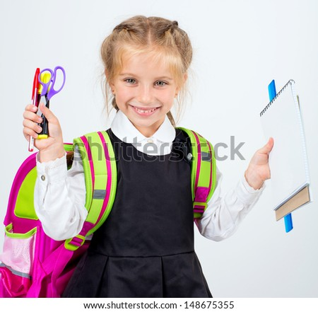 little laughing girl with a stationery on a white background - stock photo