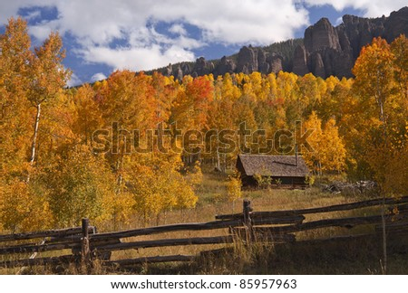 Little log cabin in a golden Aspen Grove in Colorado - stock photo
