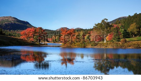 Little Long Pond Amid The Colors Of Autumn, Acadia National Park, Maine, USA - stock photo
