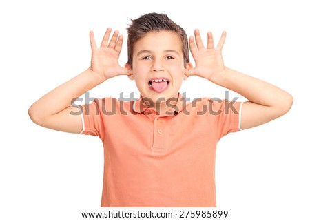 Little male kid making a face and sticking his tongue out isolated on white background - stock photo