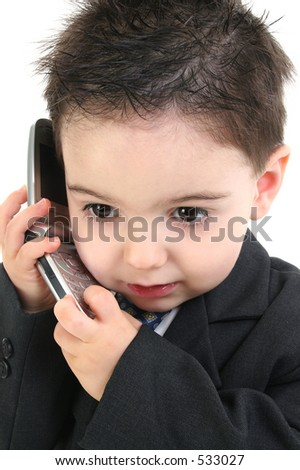 Little man discussing important business on the cell phone. - stock photo