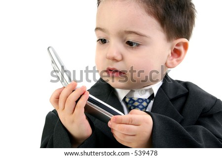 Little man discussing important business on the cell phone. Focus on eye nearest camera and hands.  Shot in studio over white. - stock photo