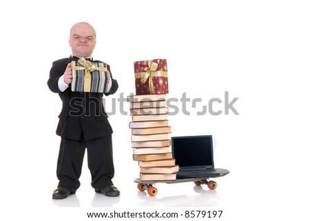 Little man, dwarf businessman doing internet xmas Christmas shopping, metaphor with skateboard, studio shot. - stock photo