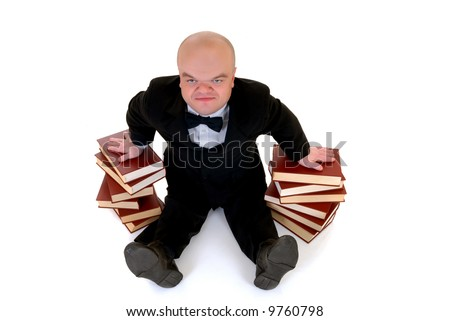 Little man, dwarf teacher in a formal suit leaning on stack of books, encyclopedia, studio shot, white background - stock photo