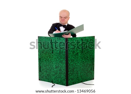 Little man, dwarf waiter in a formal suit with bow tie and over sized menu card, studio shot, white background - stock photo