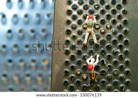 Little mans climbing on kitchen grater. Concept sport, recreation. - stock photo