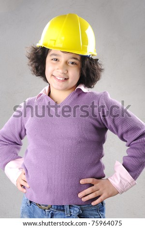 LIttle master girl engineer with helmet - stock photo