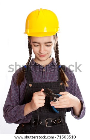 LIttle master girl with pliers - stock photo