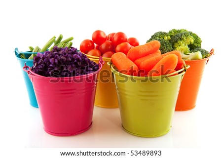 Little metal buckets with fresh vegetables on white background - stock photo