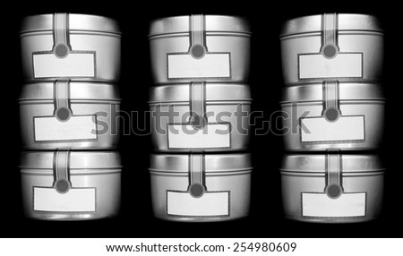 little metal spice containers over black - stock photo