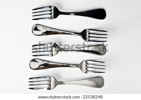 little metallic forks on gray background