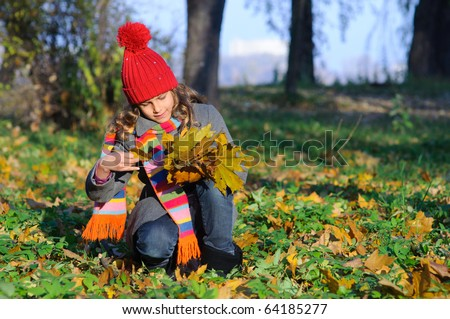 Little Miss. Pretty cute girl walks in autumn park