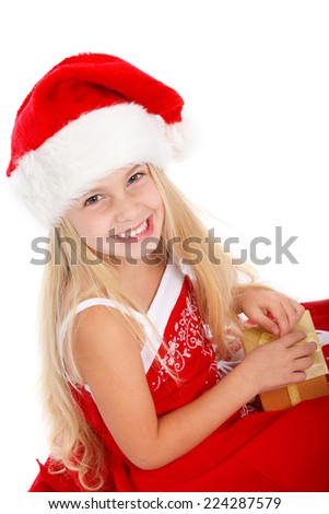 little miss santa with a christmas gift - stock photo