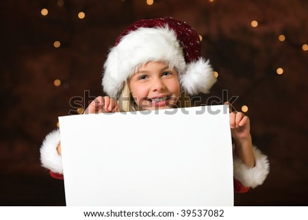 little miss santa with a empty list of wishes - stock photo