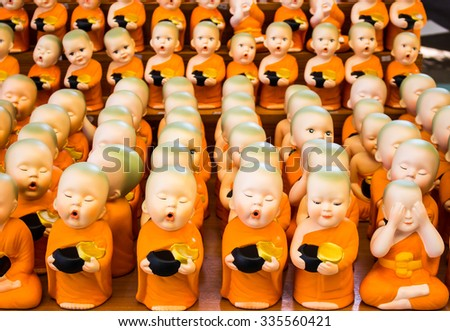 little monk statue which be nice at wat saman, thailand - stock photo
