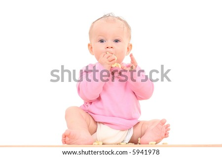 little 6 months baby girl with snack isolated on white - stock photo