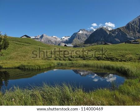 Little Mountain Lake And Mountains - stock photo