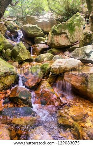 Little mountain river waterfall. Shot in Hottentots Holland Mountains, Vergelegen area, near Somerset West, Western Cape, South Africa. - stock photo