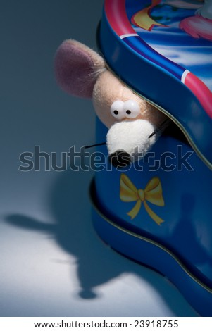 little mouse look out of a box - stock photo