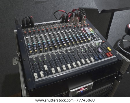 Little music mixing board sitting on it's road case. - stock photo