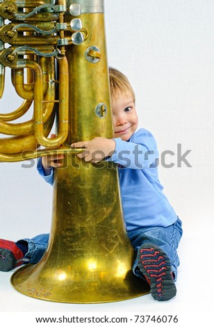 Little musician. - stock photo