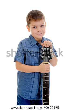 Little musician playing guitar. Isolated on a white background - stock photo