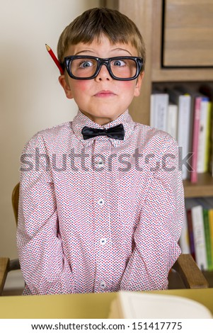 little nerdy boy with geeky goggles, making facial expressions. - stock photo