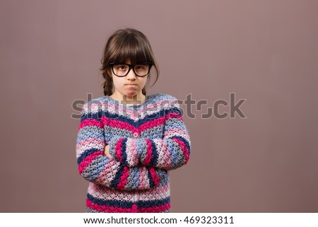 Little nerdy girl is very angry because of something.Angry nerdy girl