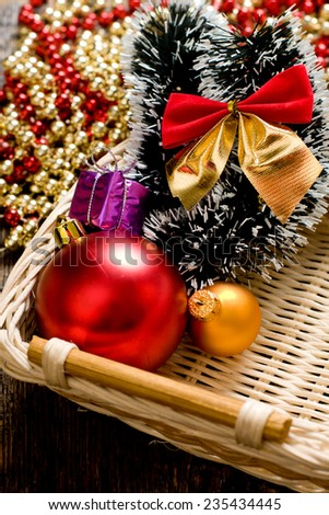 Little New year tree toys in the box closeup - stock photo