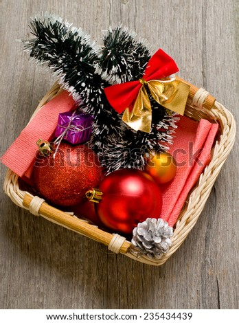 Little New year tree toys in the box on the wood backing closeup - stock photo