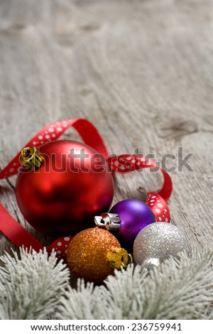 Little New year tree toys on the wood backing - stock photo