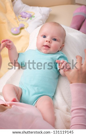 little newborn baby in the arms of mother - stock photo