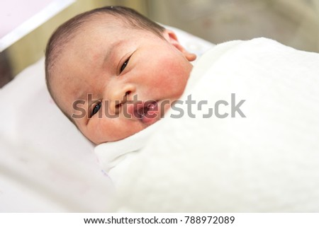 Little newborn sleeping in the bed after delivery
