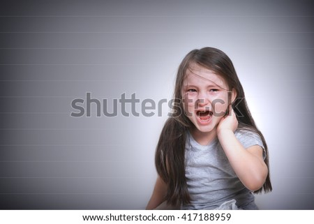 little offended girl cries and scream - stock photo