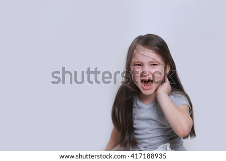 little offended girl scream and cries. isolated - stock photo