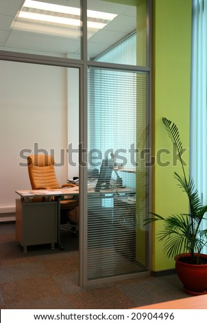Little office study behind the glass partition - stock photo