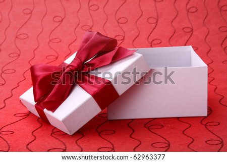 Little open red gift  on red background - stock photo