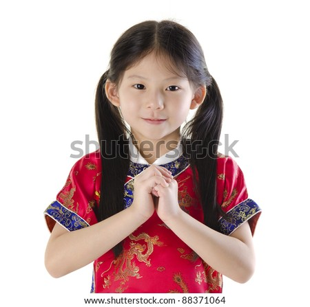 Little oriental girl wishing you a happy Chinese New Year - stock photo