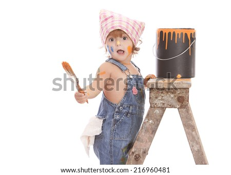 Little painter.  Adorable toddler on a ladder with a paint brush and paint can covered in paint.  Isolated on white with room for your text. - stock photo