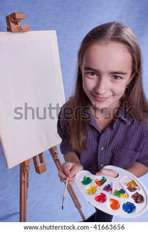Little painter and easel and brushes - stock photo