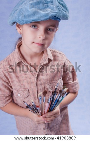 Little painter and set of brushes - stock photo