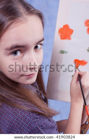 Little painter drawing with brush - stock photo