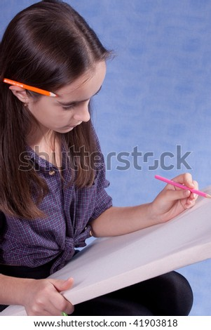 Little painter drawing with pencils - stock photo