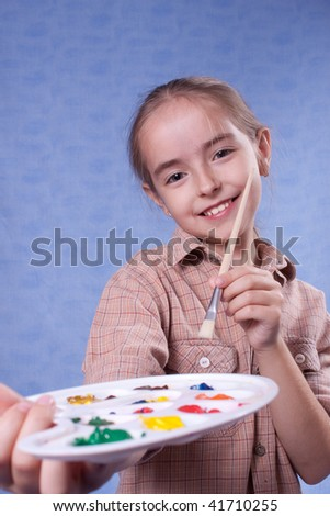 Little painter give palette to - stock photo