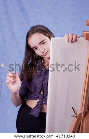 Little painter lloking behid easel - stock photo