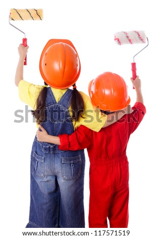 Little painters - Two kids in coveralls with paint rollers, rear view, isolated on white