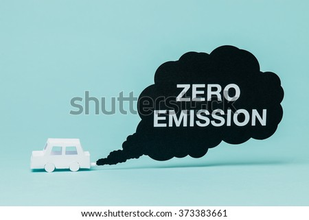 Little paper car crating a zero emission smoke cloud while running. - stock photo