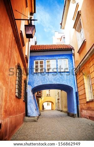 Little parasite home bridge on narrow Dawna street in Warsaw, Poland - stock photo
