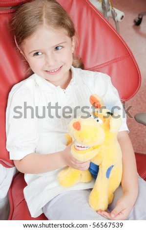 Little patient at dental clinic (no-name toy)